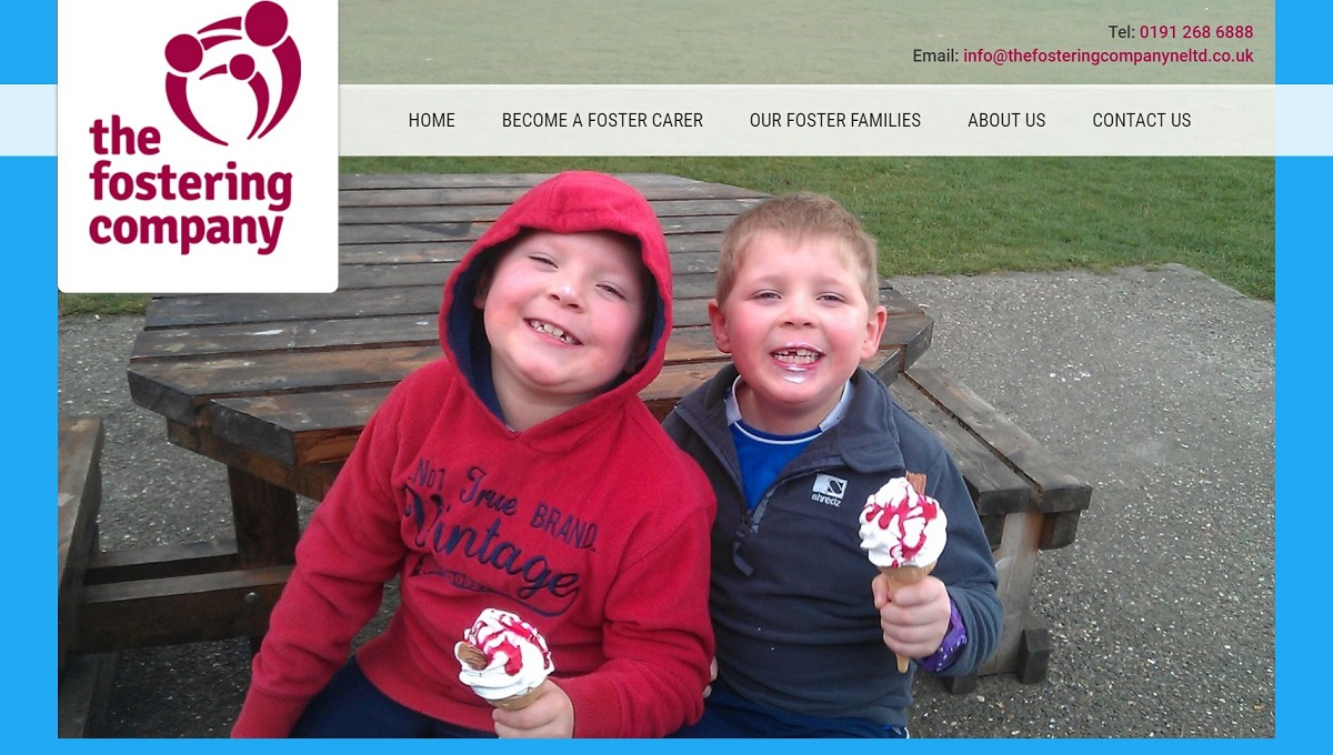 the fostering company website boys smiling icecream sitting bench grass
